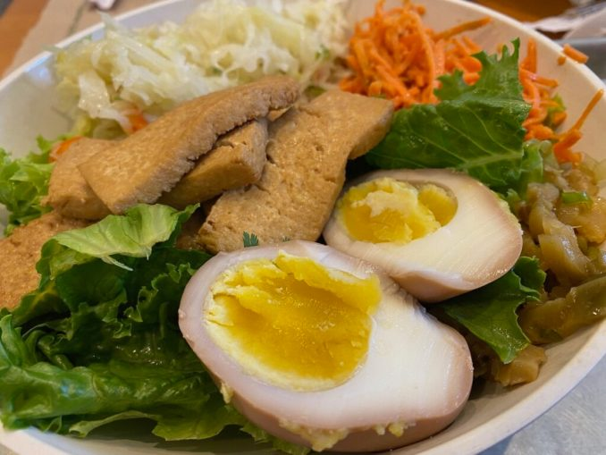 The Three Fold Salad at Three Fold comes with your choice of protein and a tea-scented egg.