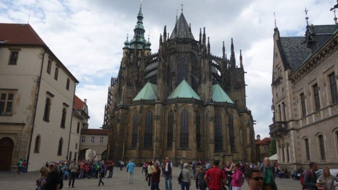St. Vitus Cathedral with visitors walking by.