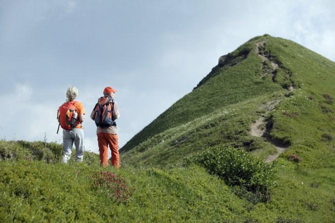Senior couple hiking in Allgau, Germany.