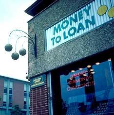 Modern pawnbroker storefront.