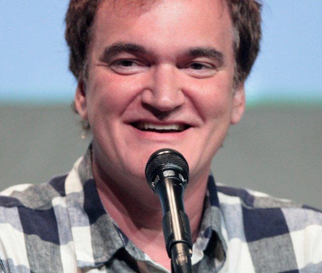 A Photograph Of Quentin Tarantino Speaking To The Press