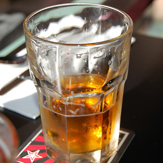 A half-drunk glass of beer