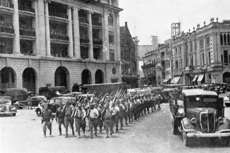 The Japanese marching through central Singapore in 1942.