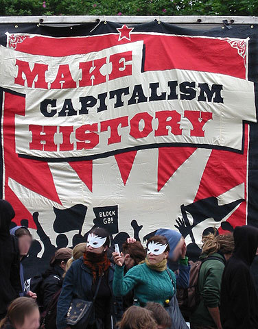 https://i1.wp.com/upload.wikimedia.org/wikipedia/commons/1/17/Make_Capitalism_History_Rostock_1.jpg