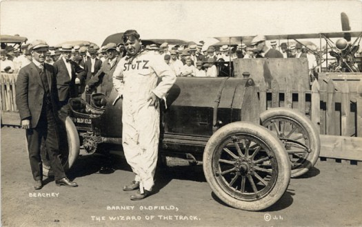 English: Barney Oldfield posing with race car ...