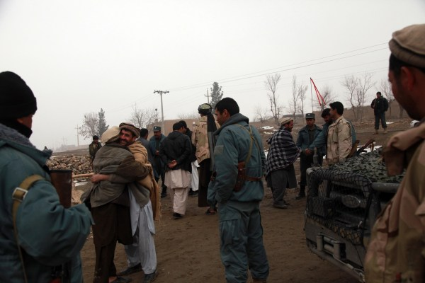 File:Members from the Afghan National Police (ANP) greet ...