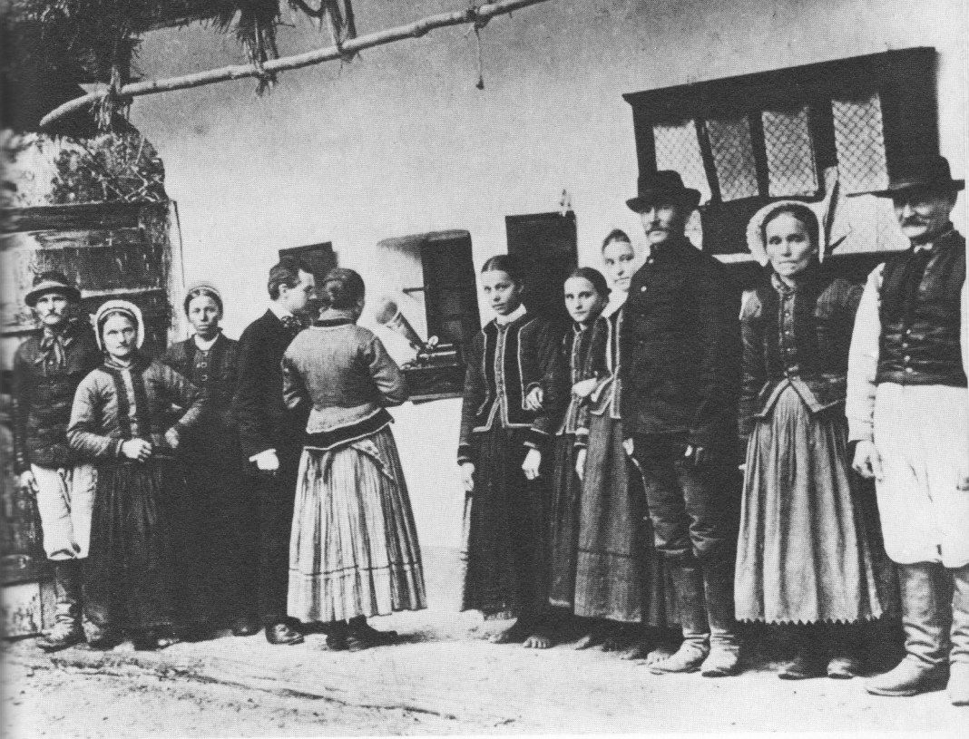 Béla Bartók using a gramophone to record folk songs sung by peasants in what is now Slovakia