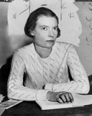 Dorothy Day half-length portrait, seated at de...