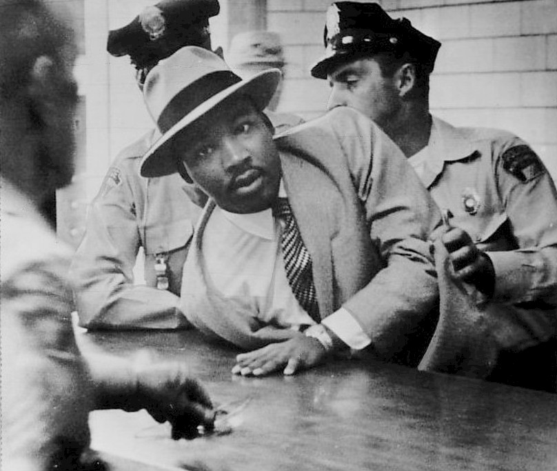 https://i1.wp.com/upload.wikimedia.org/wikipedia/commons/2/27/Martin_Luther_King,_Jr._Montgomery_arrest_1958.jpg
