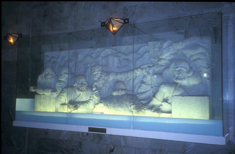 Scenes from the Shāhnāmeh carved into reliefs at Tus, where Ferdowsi is buried.