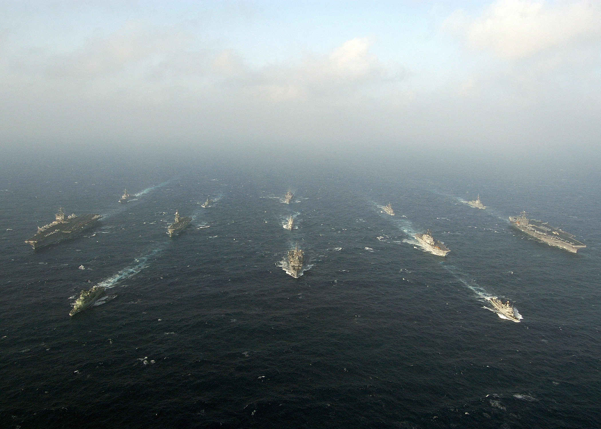 http://upload.wikimedia.org/wikipedia/commons/3/30/US_Navy_040712-N-5405H-101_USS_Enterprise_(CVN_65),_left,_and_USS_Harry_S._Truman_(CVN_75),_right,_steam_through_the_waters_of_the_Atlantic_Ocean_in_formation_with_other_US_Navy_ships_and_multi-national_warships_as_part_of_Maje.jpg