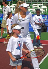 Anna Kournikova at a tennis clinic.