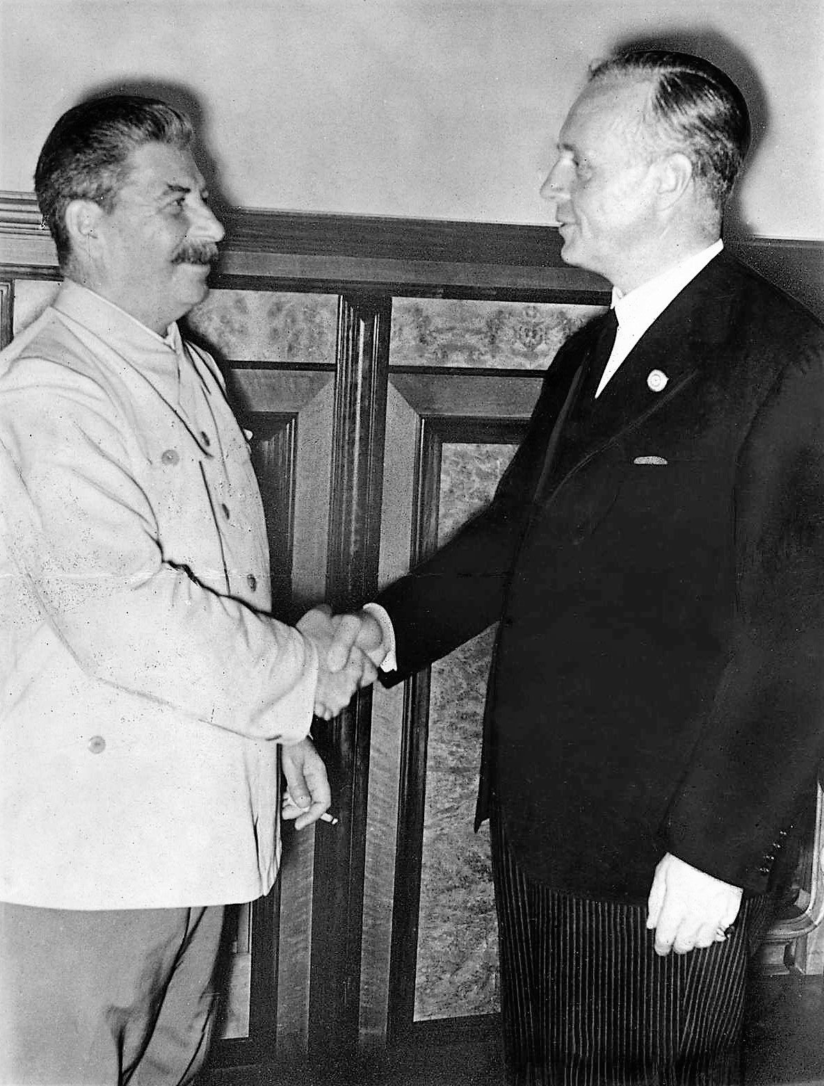 Ribbentrop and Stalin after the signing of the pact, 1939, August 23.