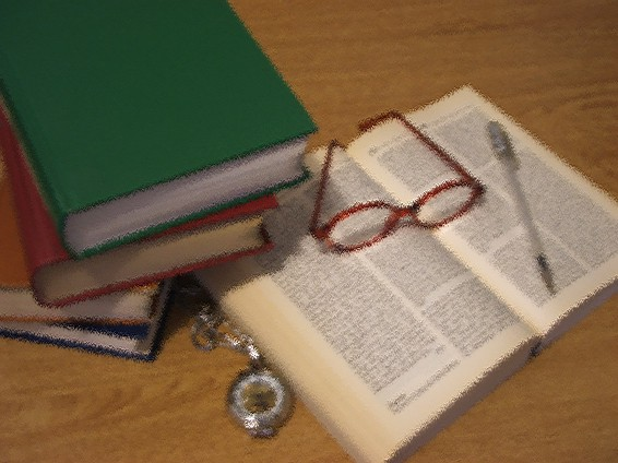 Books, glasses, pen