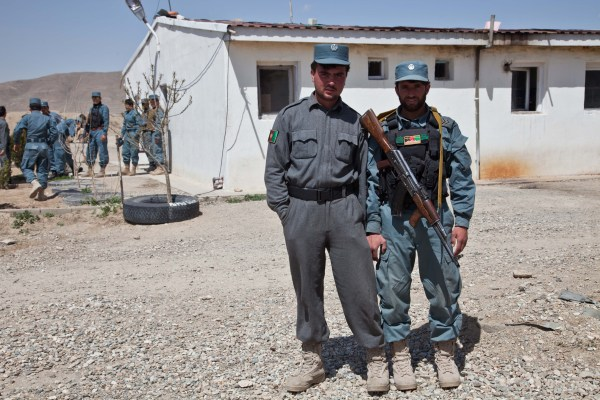 File:Afghan Uniform Police officers take a break from ...
