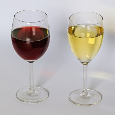 Two glasses of wine, red and white.