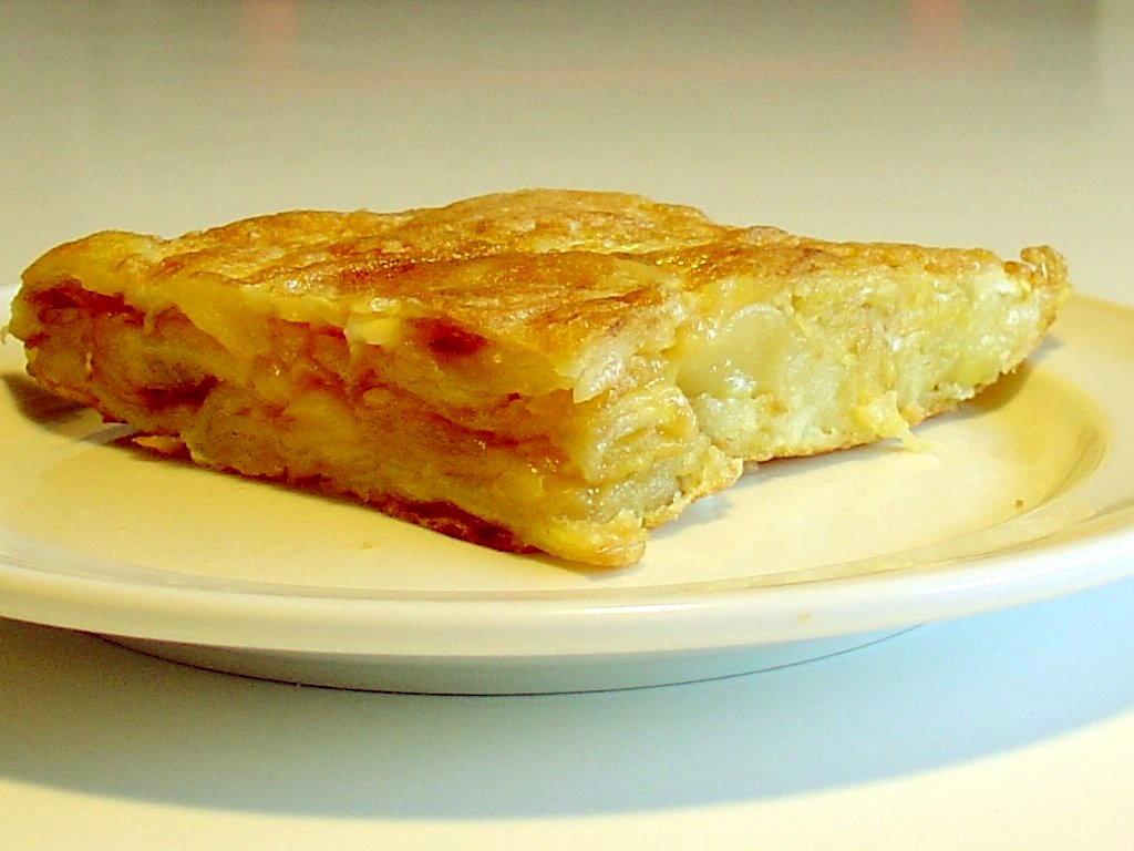 A portion of Spanish tortilla. Thickness and t...