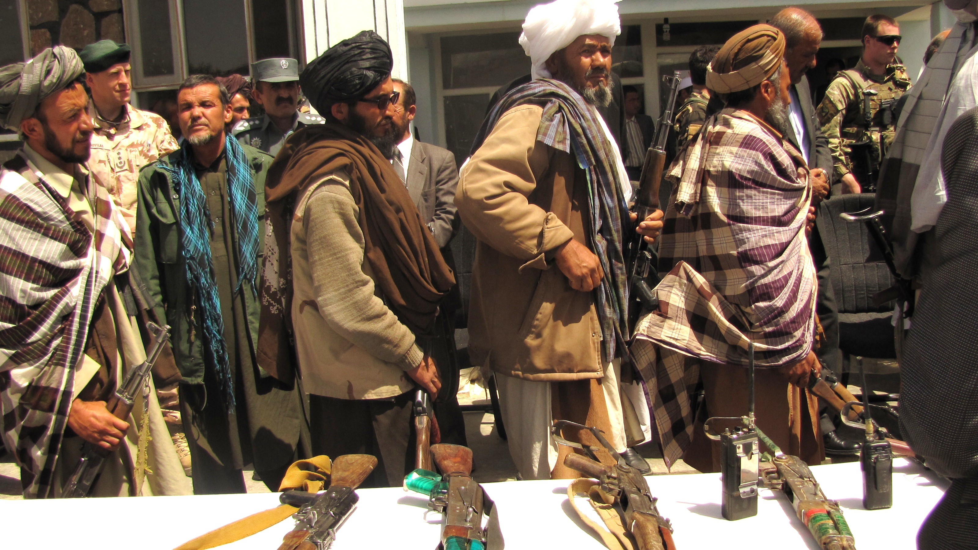 Taliban fighters surrender their arms, Afghanistan