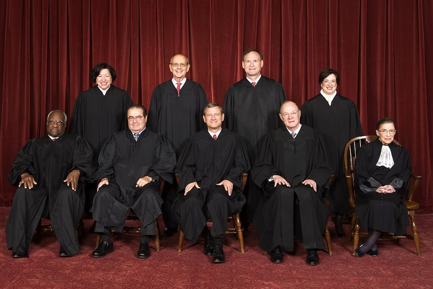 The Supreme Court (Scalia, second from the left seated, has passed away)