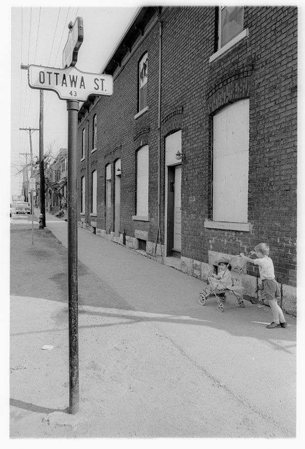 Two children in the half-abandoned LeBreton Flats in 1963. Image courtesy Wikipedia.
