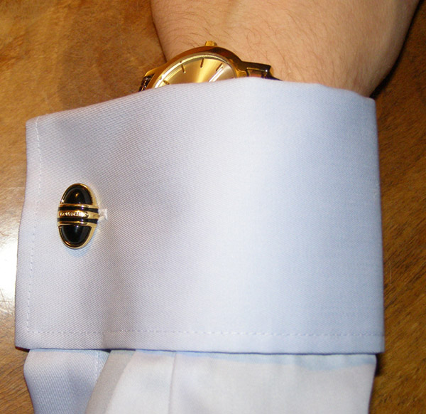 matching cufflinks and wristwatch