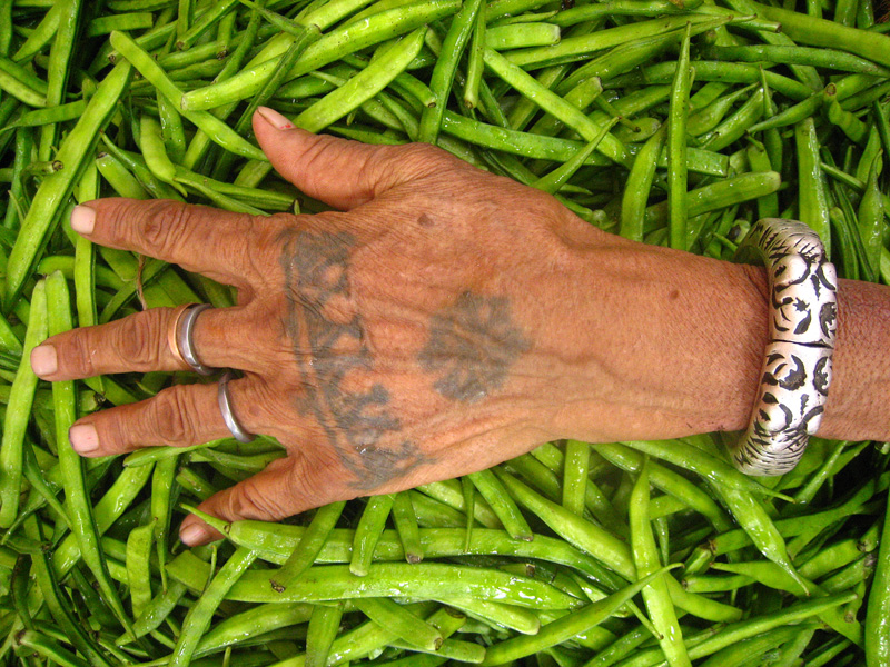 A tribal hand tattoo in a market in Jaipur, India.