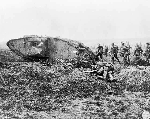 Canadian troops advancing behind a British Mark II tank at the Battle of Vimy Ridge.