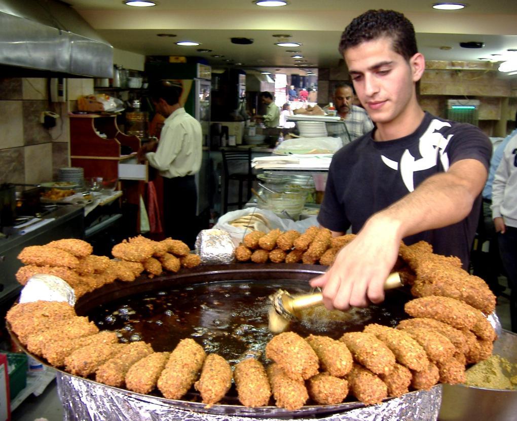 Palestinian man frying falafel in Ramalah
