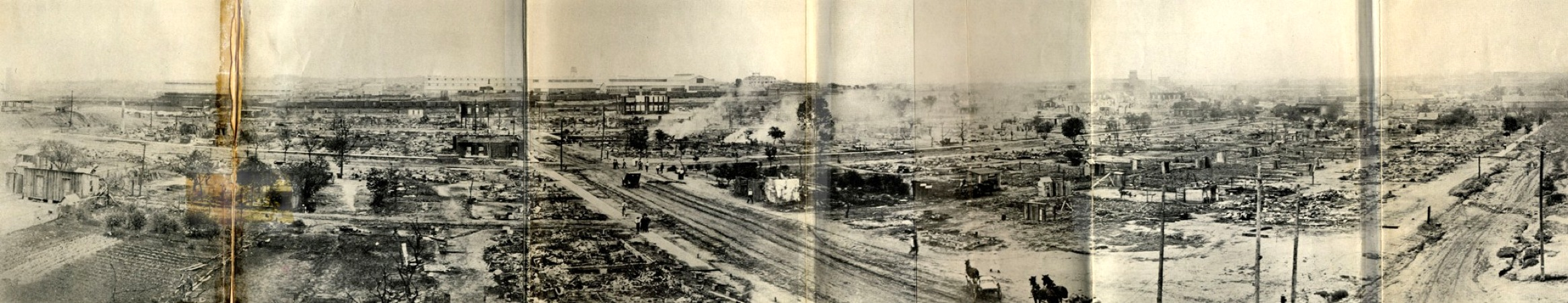 https://i1.wp.com/upload.wikimedia.org/wikipedia/commons/5/5f/Panorama_of_the_ruined_area_tulsa_race_riots.jpg