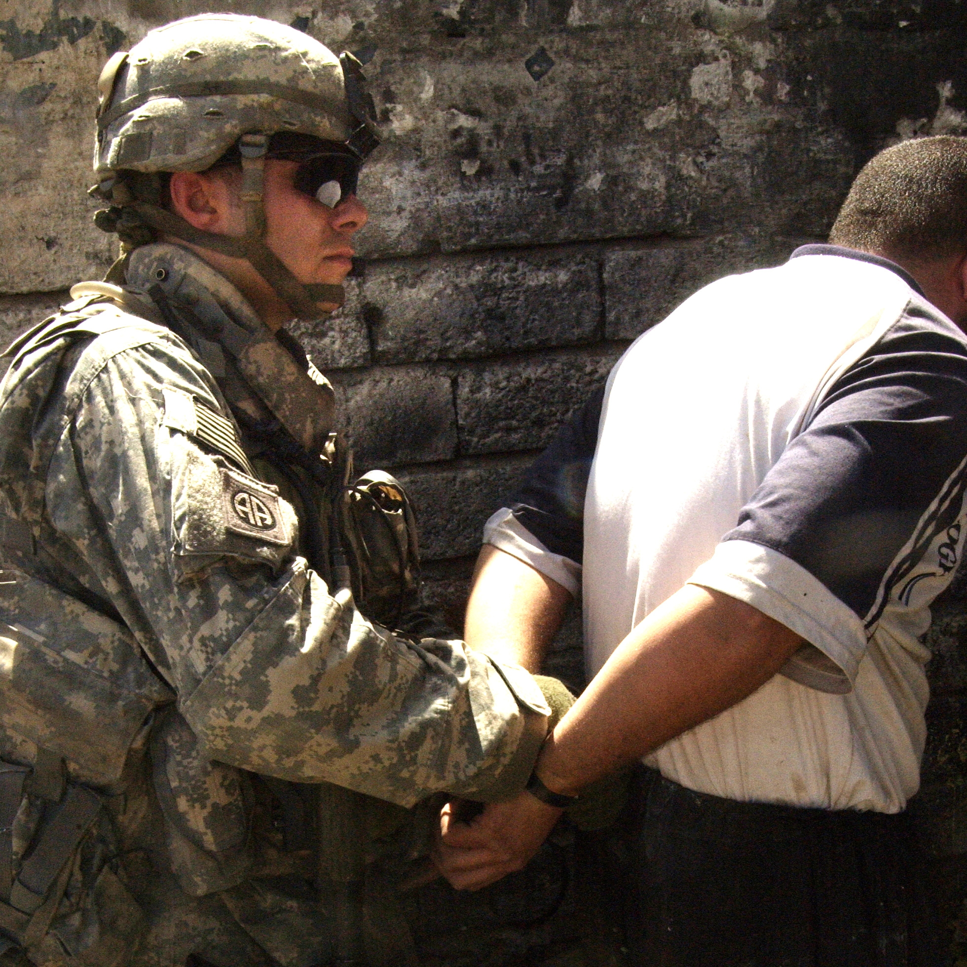 Spc. Colby Richardson detains a man after he i...