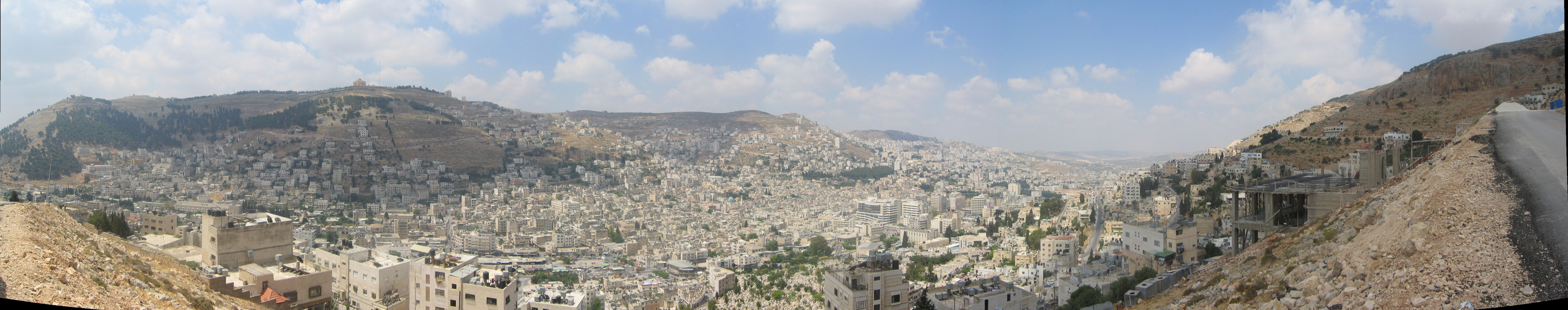 Nablus, showing Mount Ebal (right) and Mount Gerizim (left of picture). Photo from Wikimedia Commons by uwea.