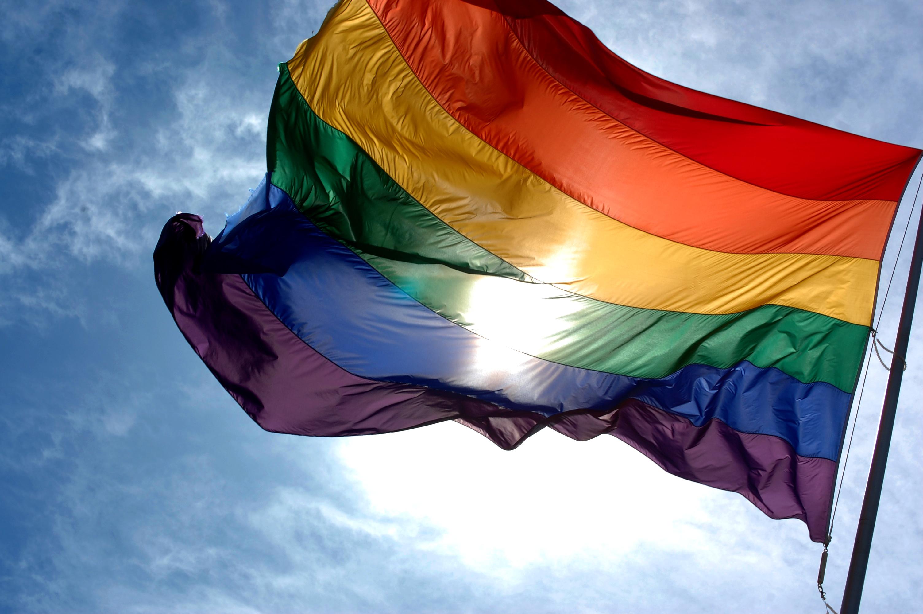 Rainbow flag and blue skies.jpg