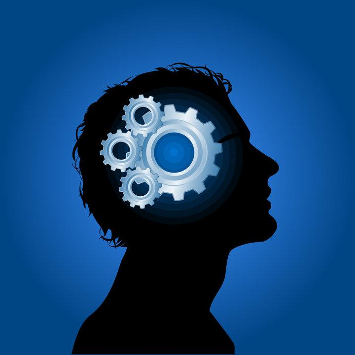Stylized image: head in silhouette with gears in brain space.