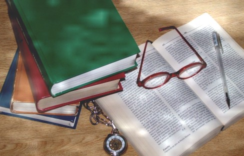 Image of books and a pair of eye glasses
