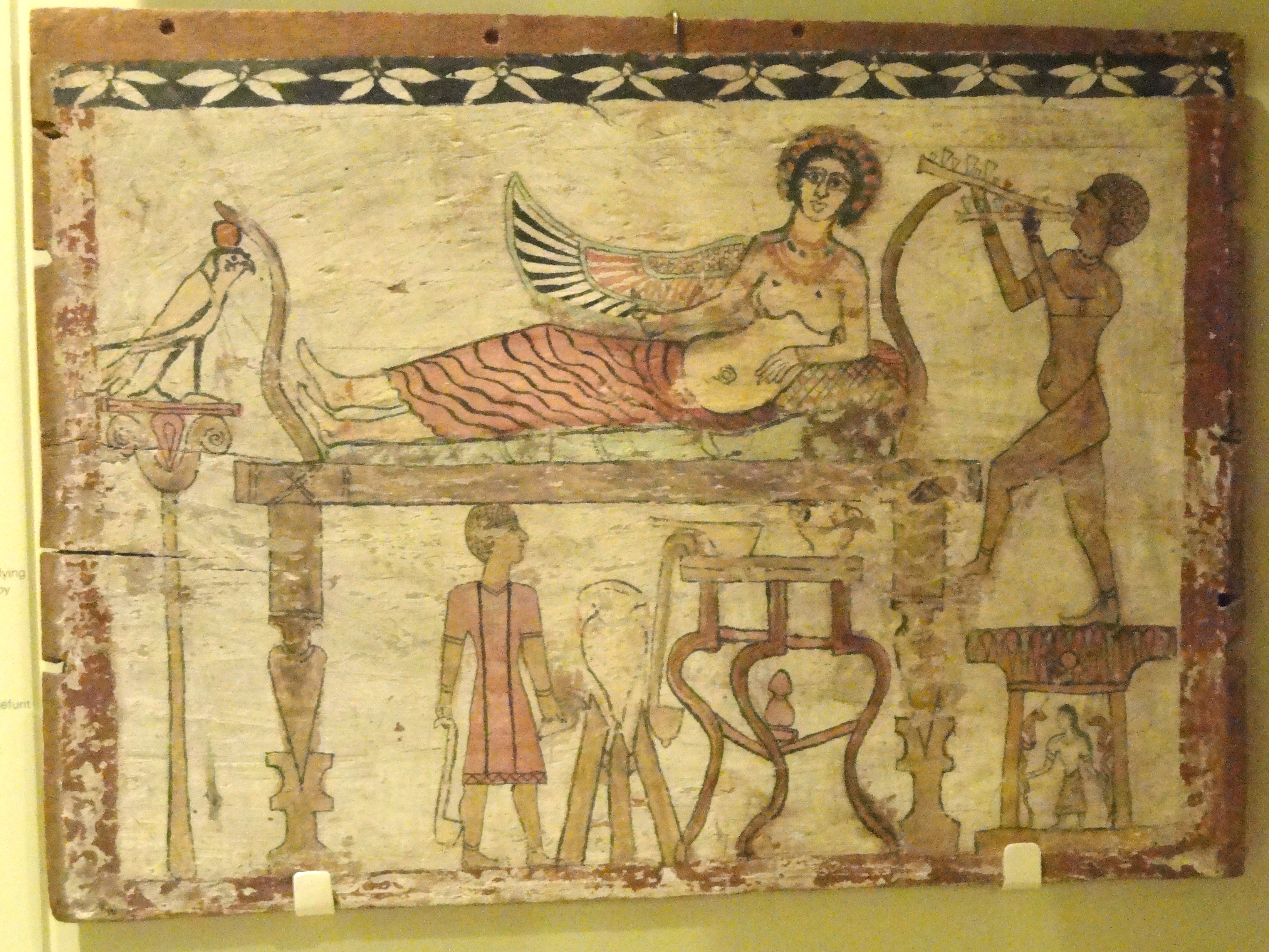 https://i1.wp.com/upload.wikimedia.org/wikipedia/commons/7/76/Coffin_floorboard_depicting_Isis_being_served_wine_by_the_deceased%2C_Egypt%2C_Roman_Period%2C_30_BC_-_AD_324_-_Royal_Ontario_Museum_-_DSC09735.JPG