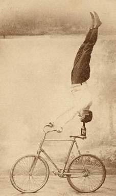 A modified headstand exercise in artistic cycling.