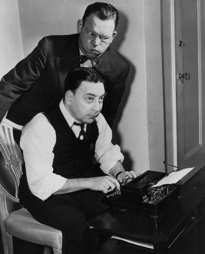 Publicity photo of comedian Fred Allen and colmunist Earl Wilson to promote Allen's radio show, which they were the sponsor of. Wilson was making a guest appearance on the program to promote his new book.