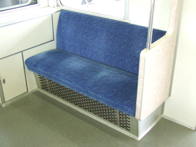 Priority seats in the tokyo metro as they look today - maintained but worn out and depreciated.