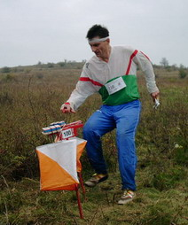"An orienteer about to ""punch"" at a c..."