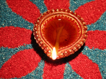 File:Oil lamp on rangoli.jpg