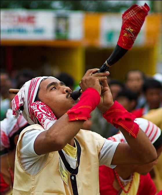 Bihu dancer with a horn