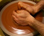 "English: An artist ""centering"" clay ..."