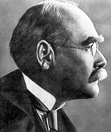 Rudyard Kipling, staring at the coloreds in contempt.