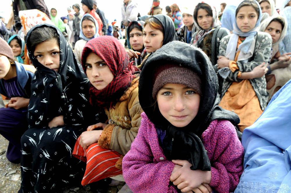 GOZARAH, Afghanistan-Village girls wait as the...