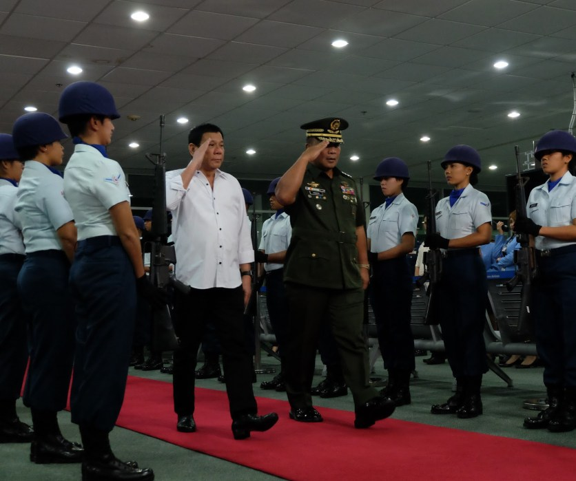 Philippine President Duterte escorted by armed forces.