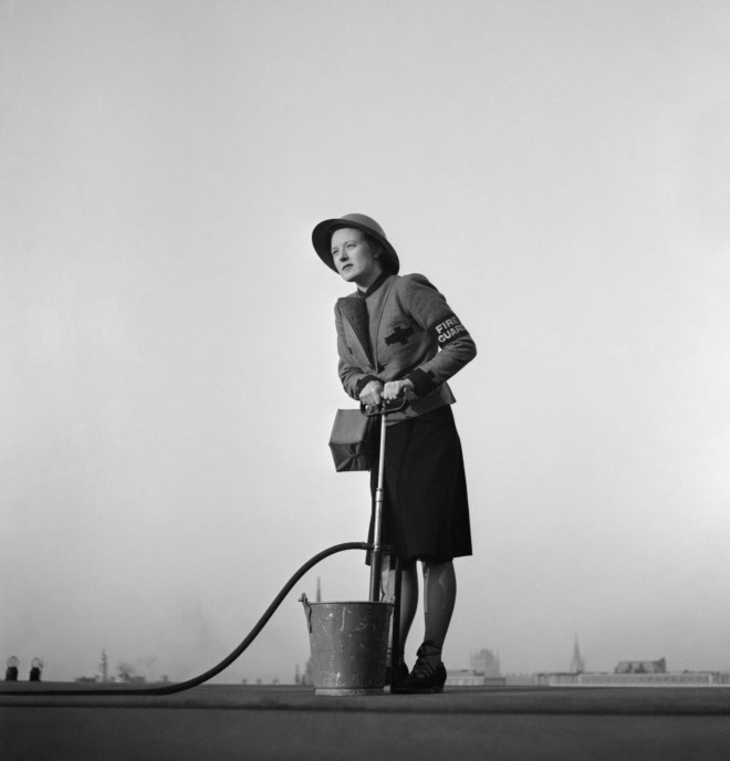 File:A female Fire Guard using a stirrup pump on the roof of a building in London, 1941. D5007.jpg