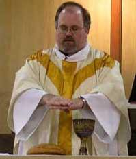 Dr. Gregory S. Neal, UM Elder, presides at the...