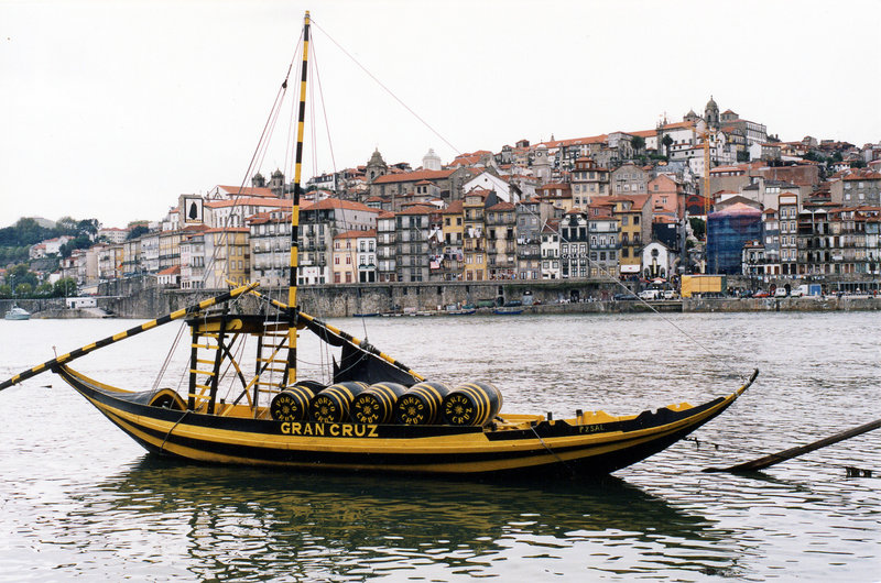 Barco Rabelo with barrels of port wine