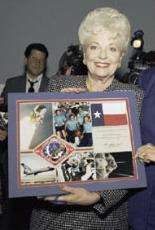 Texas Governor Ann Richards holds plaque of ST...