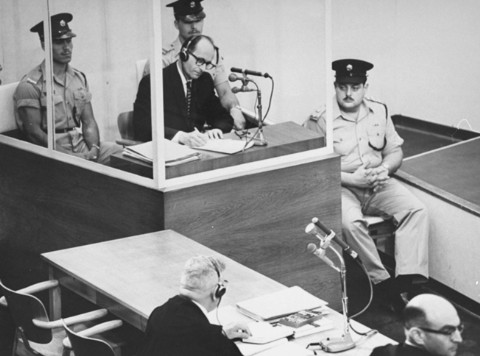 Adolf Eichmann takes notes during his trial USHMM 65268